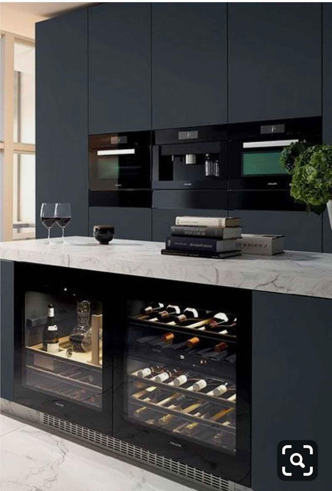 kitcehn island with built in wine cabinet
